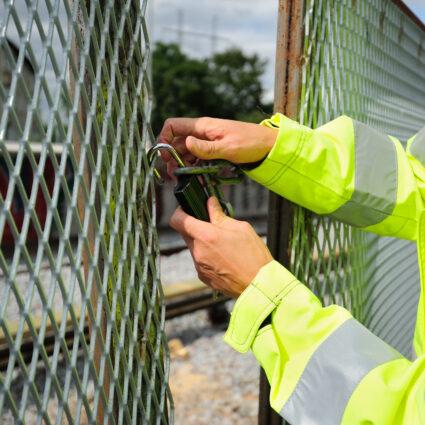 Man opening padlock